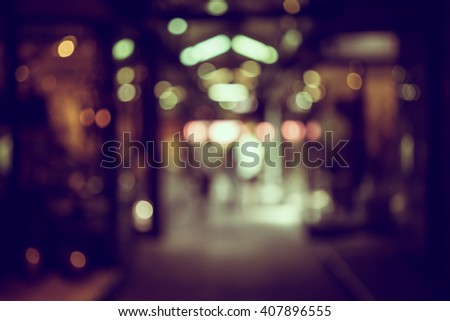 Blur or Defocus image of walk way in market or shopping mall for use as Background
