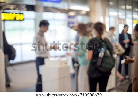 Blur people in line for hand check ticket before go to airplan in airport station terminal