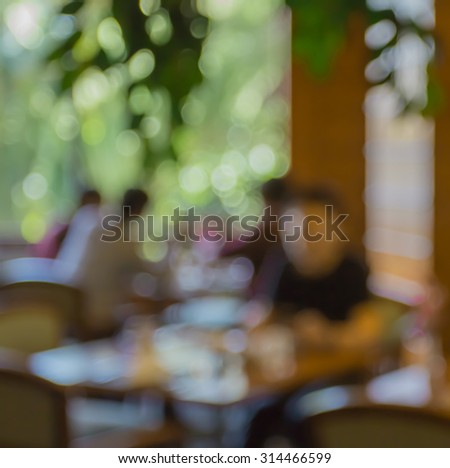 blur people  sitting on seat in dining room with bokeh