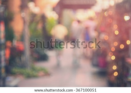 Blur people walking in shopping center mall abstract background.Retro color style. - stock photo