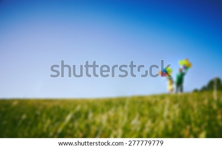 Blur photo of Happy boy and girl with balloons running together - stock photo