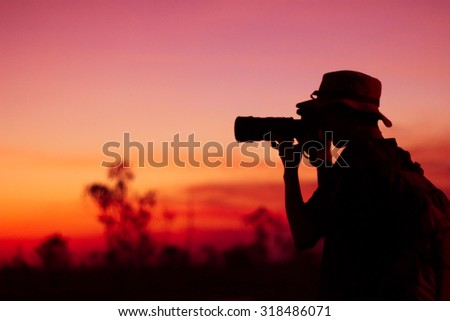 Blur photographer take a picture silhouette  sunset