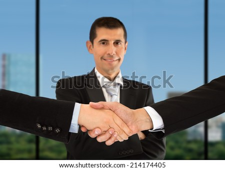blur portrait of a executive and close up of handshake - stock photo