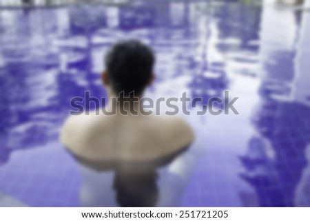 Blur Portrait of a fit swimmer in the pool. - stock photo