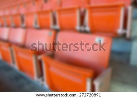 blur red stadium seats - stock photo