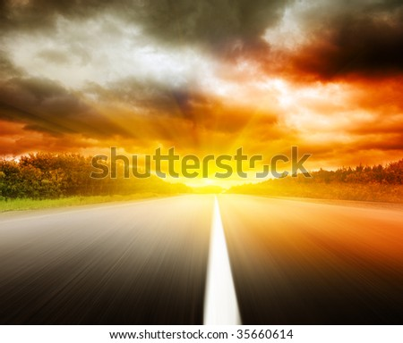 blur road and dramatic sky - stock photo
