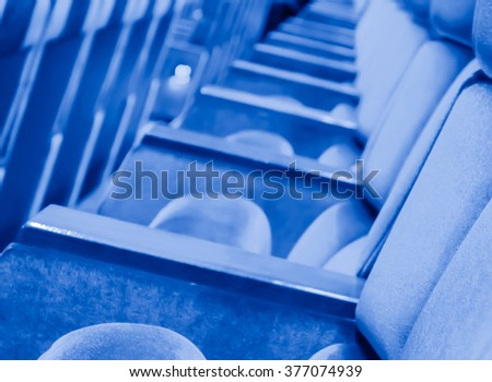 blur row of  empty blue auditorium or theater seat - stock photo
