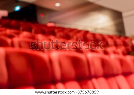 blur row of  empty red auditorium or theater seat - stock photo