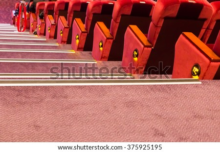 blur row of red classroom or auditorium  or theater seat and stair - stock photo