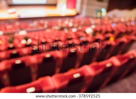 blur  row of  red seat  and stage in auditorium  or theater - stock photo