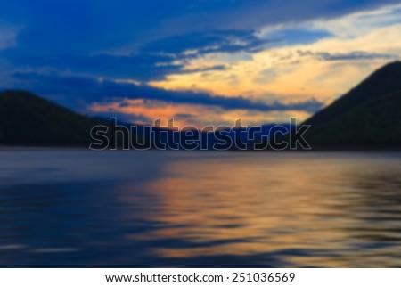 blur scene of lake after sunset at Kanchanaburi Thailand - stock photo