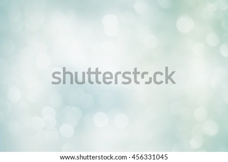 Blur shining brighten soft teal white silver wallpaper with circle lantern:abstract blurred background in light tone.blurry bulbs ball bulbs motion colored gradient backdrop.blurry sparkle glitter. - stock photo
