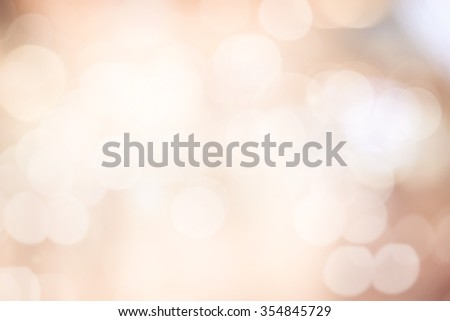 Blur shining brighten wallpaper with circle bulb light:abstract blurred background in warm toned.blurry soft of sepia cream color backdrop for decorate.xmas festive wallpaper conception.glowing bokeh. - stock photo