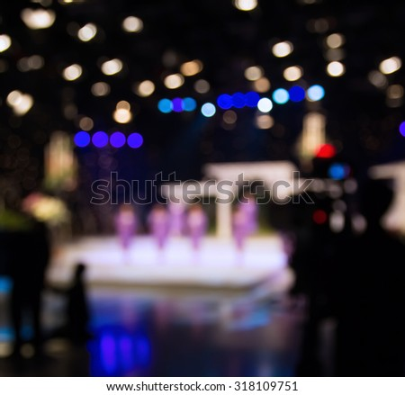 blur singer in studio of television station with camera (2) - stock photo