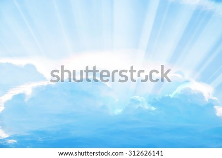 Blur sky and rays of light shining down with clouds atmospheric effect. - stock photo