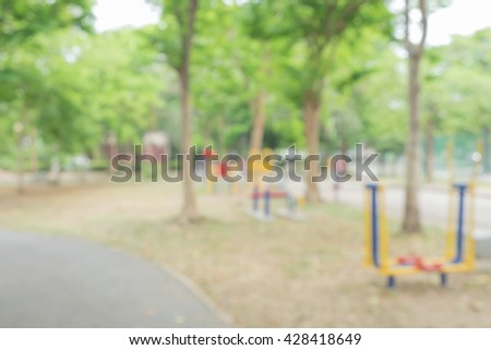 blur soil walkway and concrete street in the park, blur bench in park, place to exercise and relax, Sihouette blur training equipment in blur park, blur garden, abstract background - stock photo