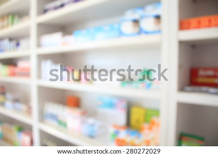 blur some shelves filled with medication in a pharmacy drugstore - stock photo