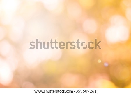 Blur sparkle brighten wallpaper with circle bulb light:abstract blurred background banner template.blurry soft orange warm tone color backdrop for decorate.festive wallpaper conception.glowing bokeh. - stock photo
