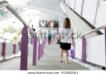 blur stairs background. women's legs go down the stairs