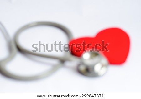 Blur Stethoscope with red heart background - Health care concept - stock photo