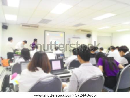 Blur student during study or lecture and exams from professor in classroom with notebook with screen projector in master degree of Engineering course or MBA class or business seminar, business meeting - stock photo