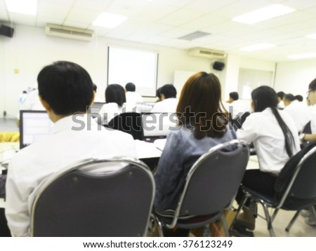 Blur student people during study or lecture and quiz with teacher or professor in classroom with laptop computer in master degree of industrial management Engineering programs or MBA at university  - stock photo