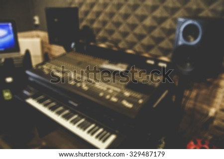 blur studio mixer & keyboard, electric piano, synthesizer in recording studio + vintage filter for music background - stock photo