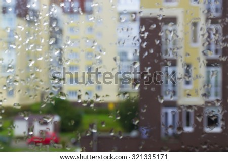 Blur the background: rain, raindrops on the window, the street - stock photo