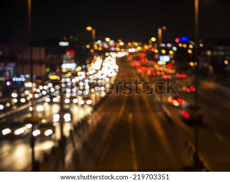 Blur traffic and car lights bokeh in rush hour background. - stock photo