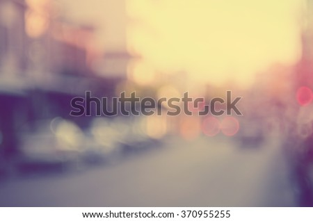 Blur traffic road with bokeh sun light abstract background.Retro color style. - stock photo