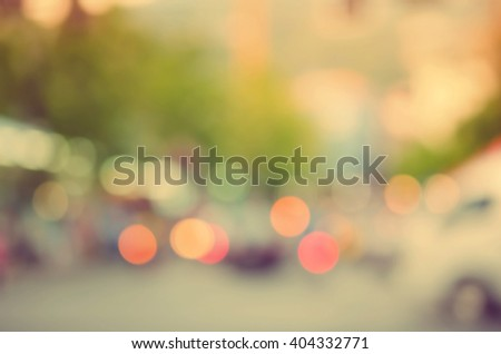 Blur traffic road with colorful bokeh light abstract background. Retro color style. - stock photo
