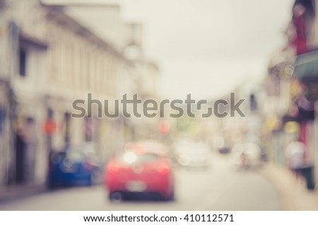 Blur traffic road with colorful bokeh light abstract background. Travel concept. Retro color style. - stock photo