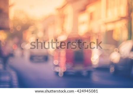 Blur traffic road with old building abstract background. Retro color style. - stock photo