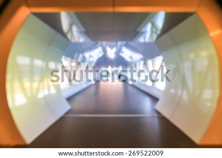 Blur Tunnel empty corridor in the modern office building - stock photo