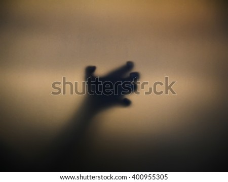 Blur view of the shadow of a horror male hand. - stock photo
