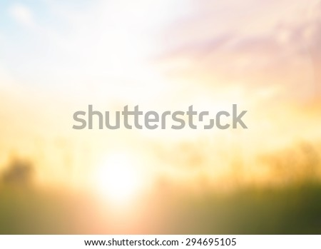 Blur vintage style art rural field grass. Scenic Yellow Color Eco Sun Idea Plant Dawn Travel Ray View Cloud Dawn Village Peace Calm Haze Healthy Bright Sunlight Season Pasture Heaven Valley Sunny Over - stock photo