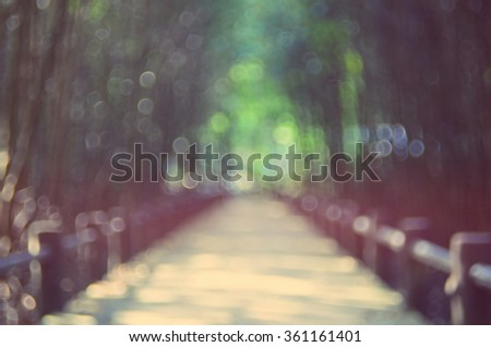 Blur walking road in nature park abstract background.Retro color style. - stock photo