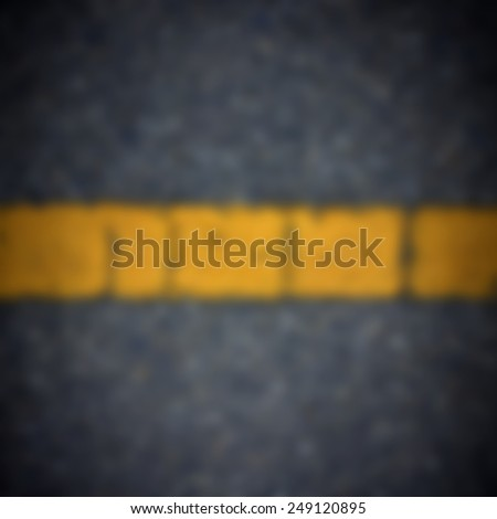 Blur yellow line on the road texture background - stock photo