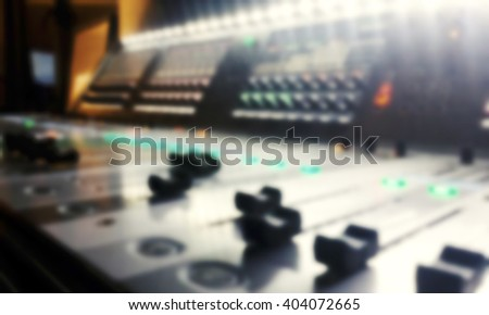 blured audio sound mixer with buttons and sliders - stock photo