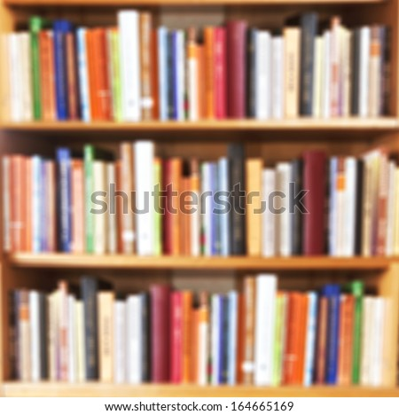 Blured books in public library. Blured effect. Background for you pictures - stock photo