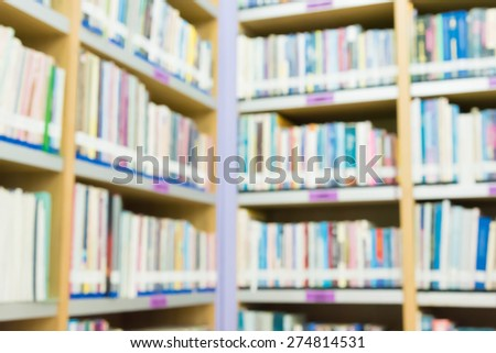 Blured books in public library. Blurred effect. Background for you pictures
