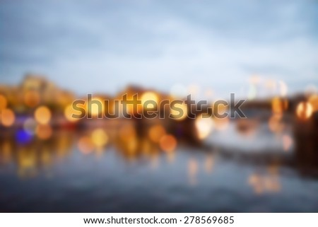 Blured lights from night Prague, view from river Vltava - stock photo