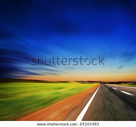 blured road and blue sky