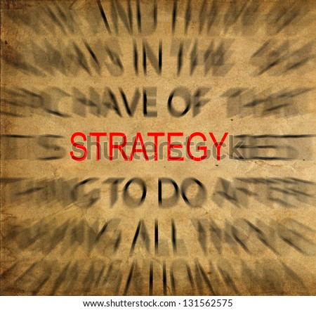 Blured text on vintage paper with focus on STRATEGY - stock photo