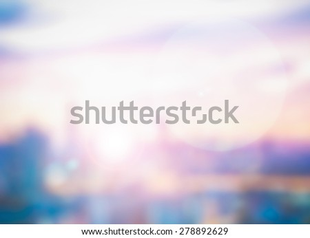 Blurred abstract background cityscape skyline colorful sunrise sky cloud sun sunny bokeh: Blurry aerial rooftop view city smokey dreamy urban landscape w/ light lens flare: World religion freedom day - stock photo