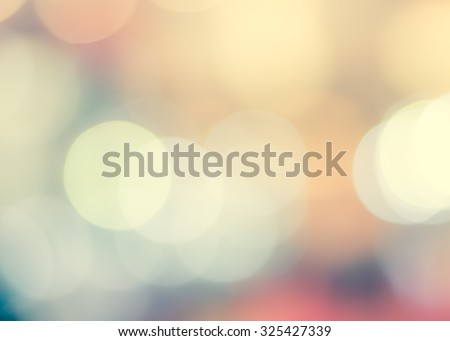 Blurred abstract background night city life with candle lights bokeh in cool vintage cyan blue green sweet color tone: Blurry view of urban cbd downtown nightlife cafe shiny retro style toned colour  - stock photo