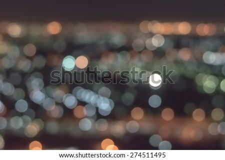 Blurred abstract background of bokeh lights city night shots from bird eye view : Blurry colorful bokeh lights of night cityscape aerial view   - stock photo
