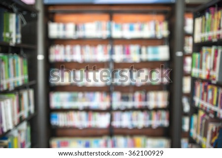 Blurred abstract background of book shelves and interior of college library with textbooks, literature, menuscripts, thesis, magazines, and seating for students and faculties for reading area - stock photo