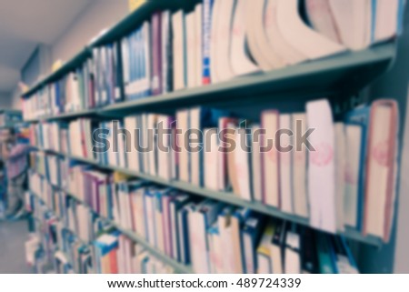 Blurred abstract background of book shelves row and interior of college library with library textbooks,library literature,library manuscript, library thesis and library magazines. - Vintage Tone.