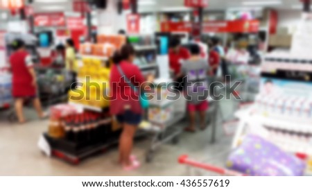 Blurred abstract background of checkout counter in supermarket - stock photo